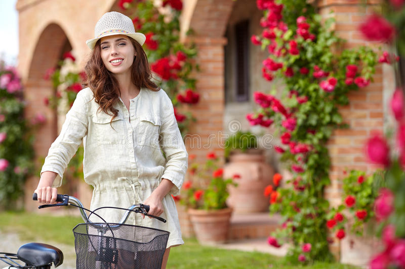 Woman in Tuscany garden. stock photos