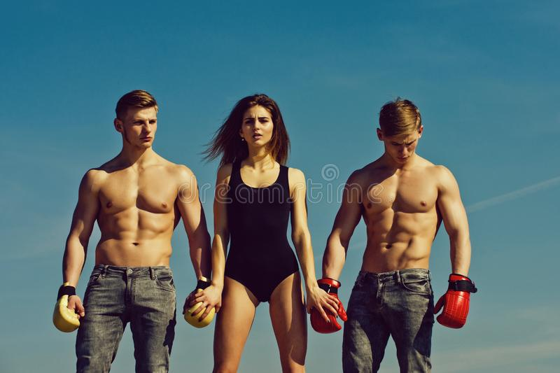 Woman and twins with muscular body. royalty free stock photo