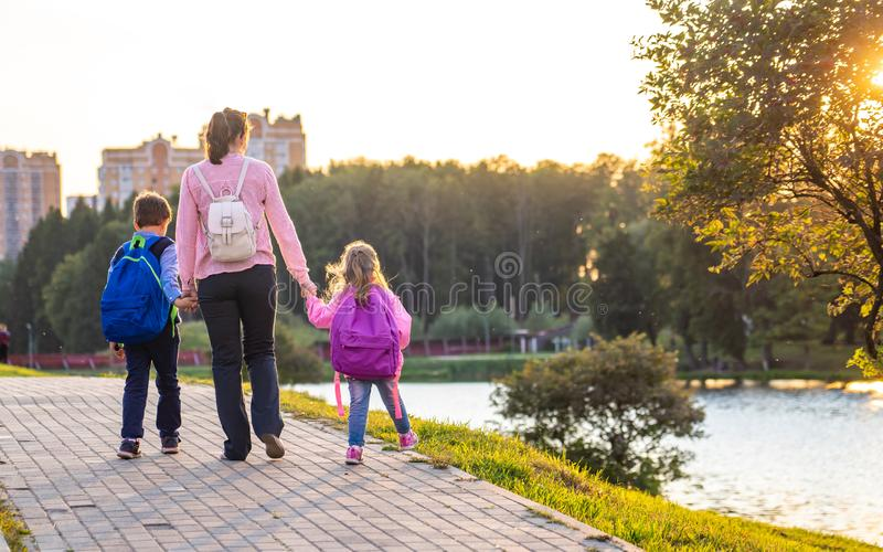 A woman and two children from the back royalty free stock photography