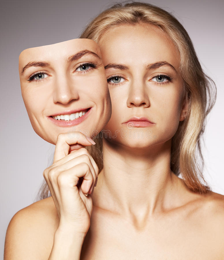 Woman with two faces. Mask stock photo