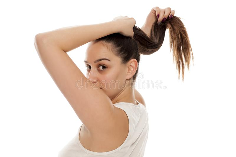 Woman tying her hair royalty free stock image