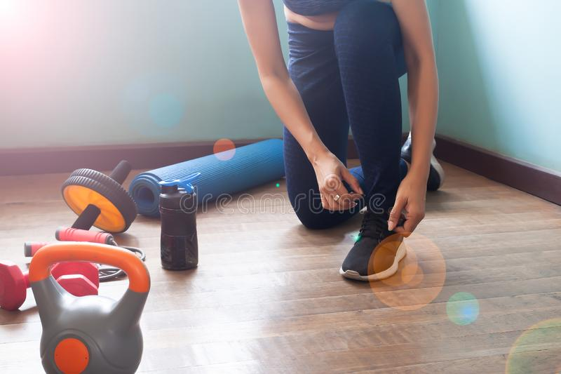 Woman tying shoes for exercise, Healthy lifestyle stock images