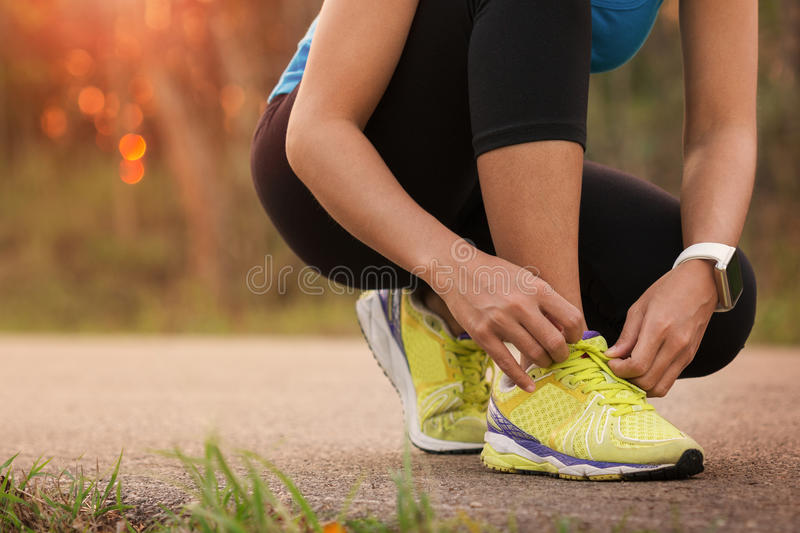 Woman tying sport shoes stock photo