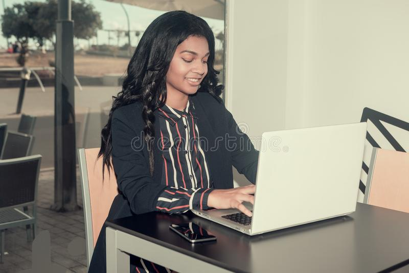 Woman typing the computer stock photography