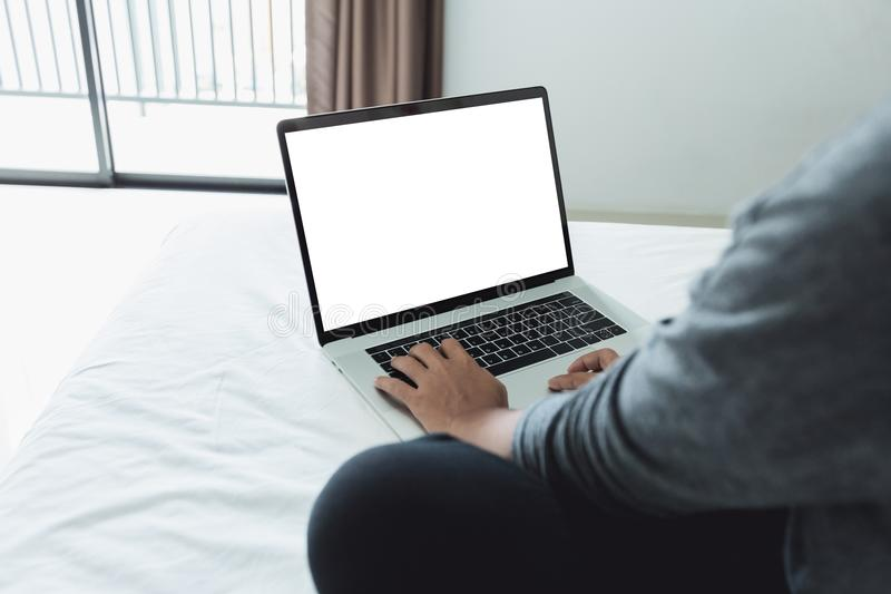 Woman typing laptop keyboard showing white screen stock photography
