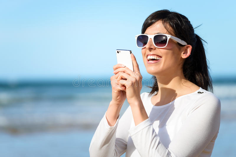 Woman typing message on cell phone royalty free stock images