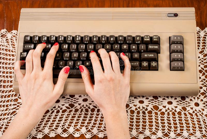 Woman typing on old computer keyboard royalty free stock photos