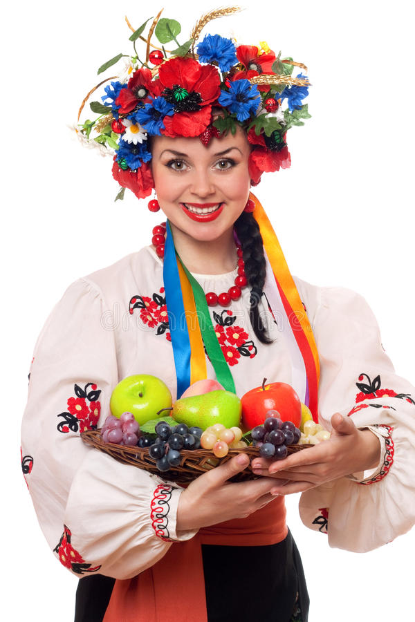 Woman In The Ukrainian National Clothes With Fruit Stock Photo
