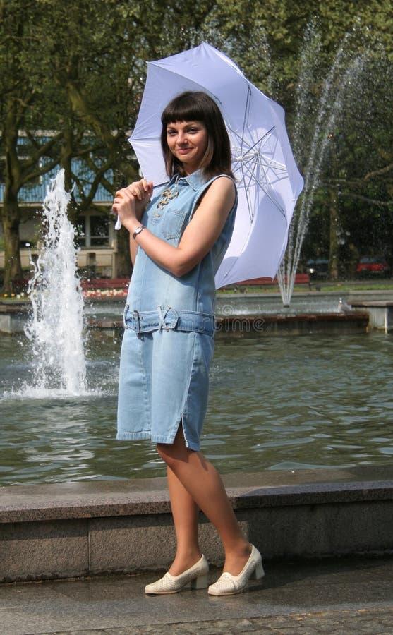 Woman with umbrella #2 stock photo