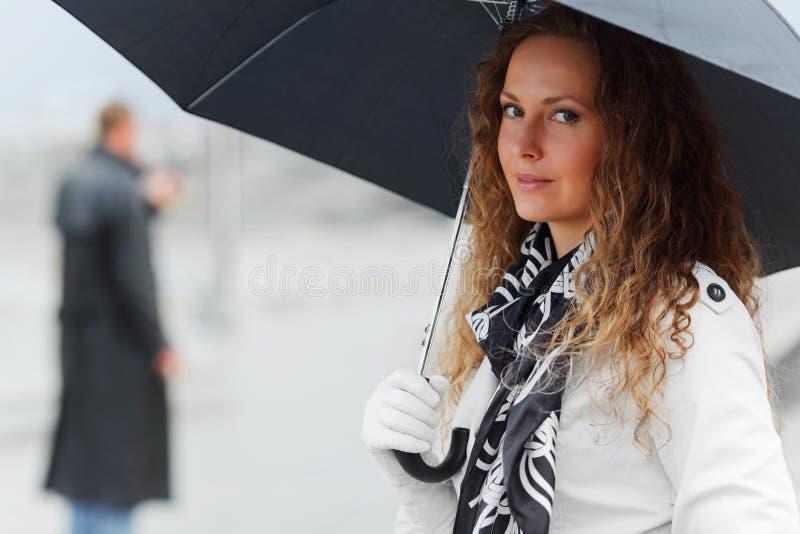 Happy fashion woman with umbrella walking outdoor stock photo