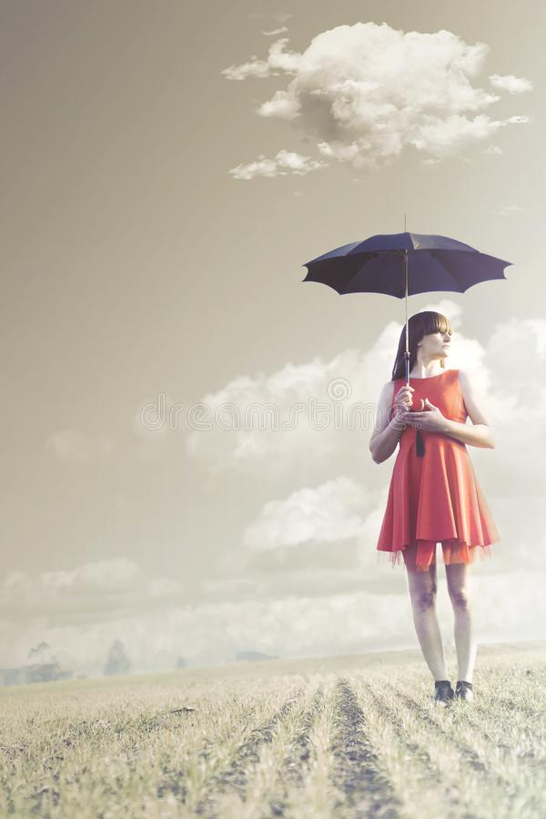 Woman with umbrella is followed by a delicate cloud. Woman with umbrella is followed by a cloud stock images