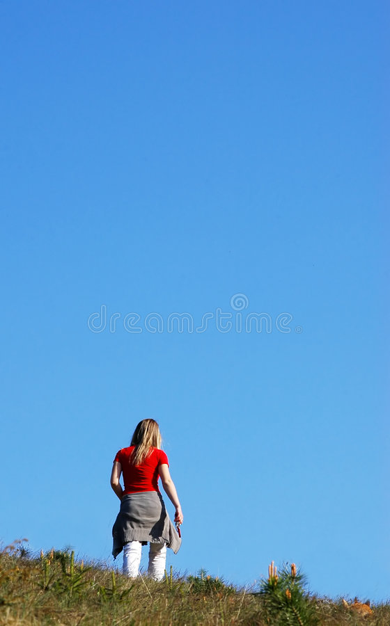 Woman under blue sky. Woman lie on blue sky and green grass royalty free stock images