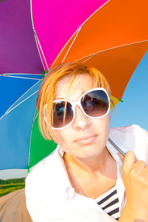 Woman under blue sky with umbrella. In field stock images