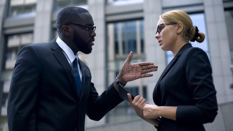 Woman under pressure at work, boss scolds secretary for mistake in annual report. Stock photo royalty free stock images