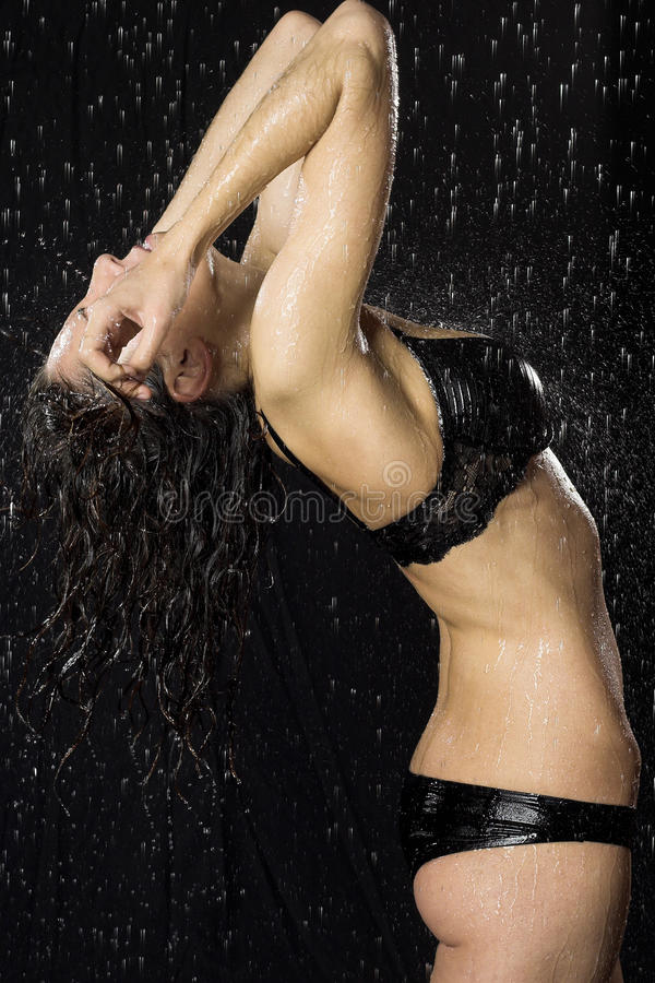 Download Woman under rain stock photo. Image of bikini, rain, person - 12357936