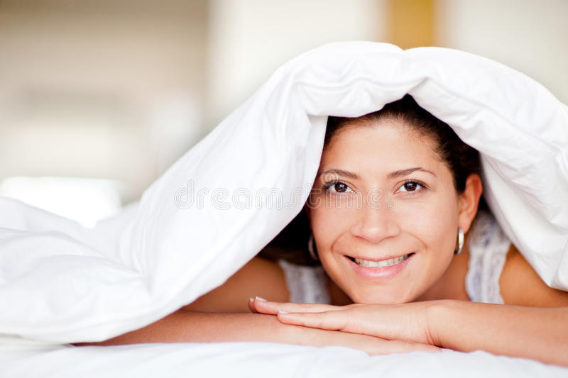 Download Woman under the sheets stock image. Image of female, interior - 22998987