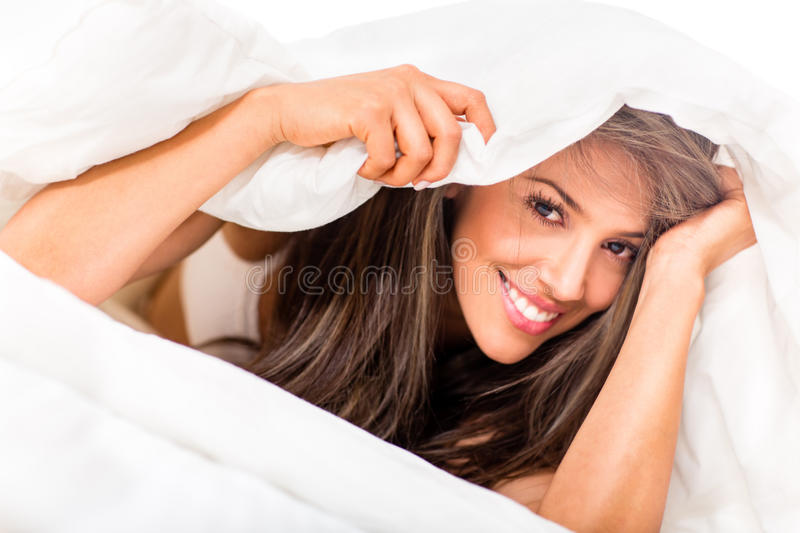 Woman under the sheets