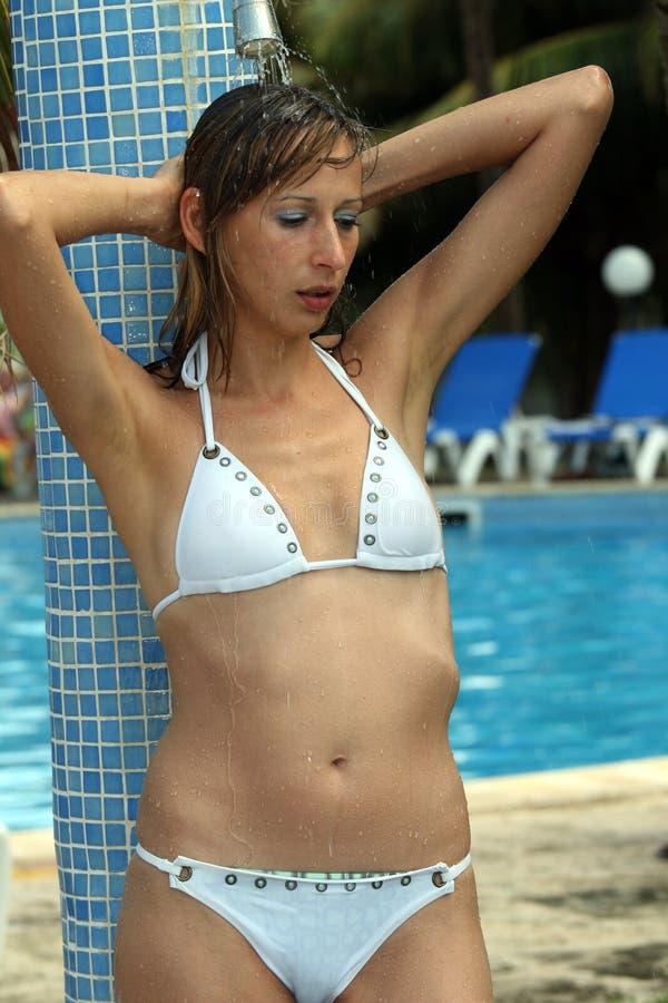 Woman under shower stock photo