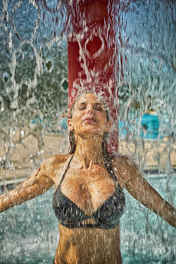 Woman Under Waterfall stock image