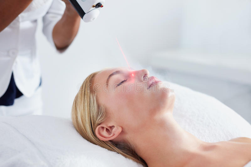 Woman undergoing local cryotherapy at spa. Localized cryotherapy session to the face of young caucasian woman. Ice cold nitrogen vapors applied to the facial stock images