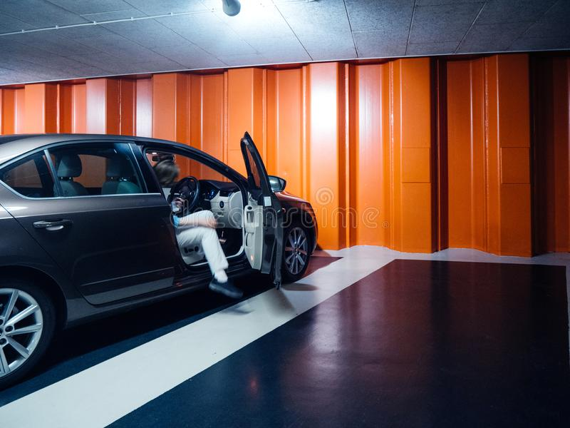 Woman in underground parking with Skoda Octavia car stock photo