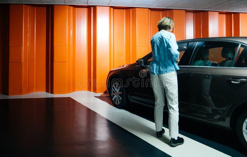 Woman in underground parking with Skoda Octavia car stock photos