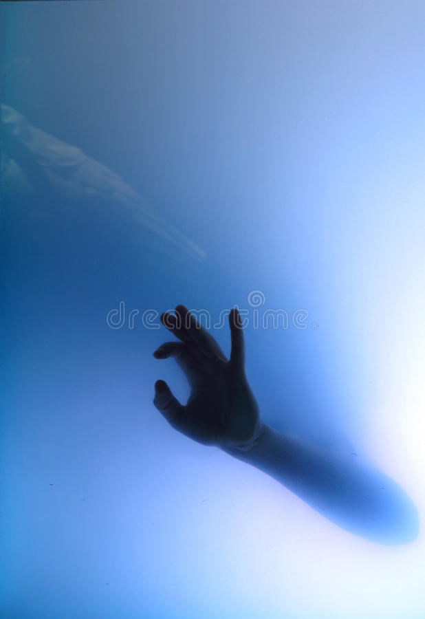 Woman underwater. Female hand giving handsign ok under water royalty free stock photos