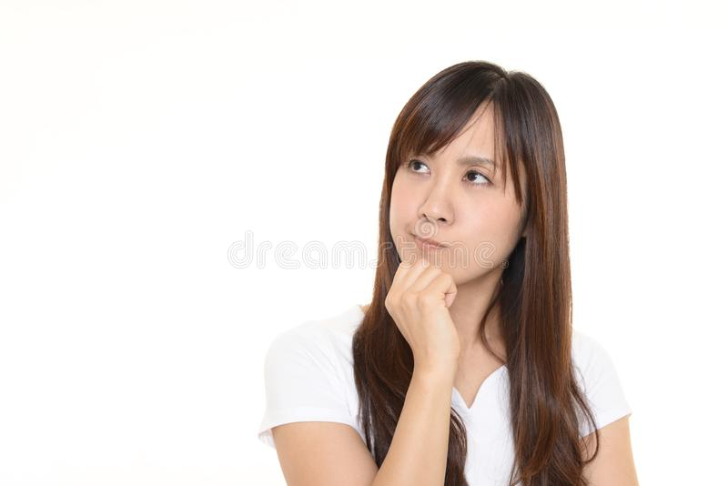 Uneasy Asian woman stock photography