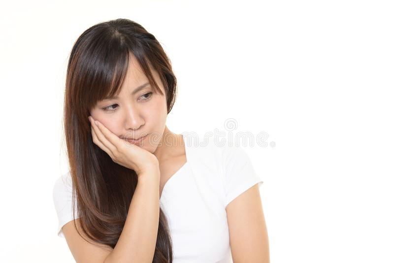 Uneasy Asian woman royalty free stock photography
