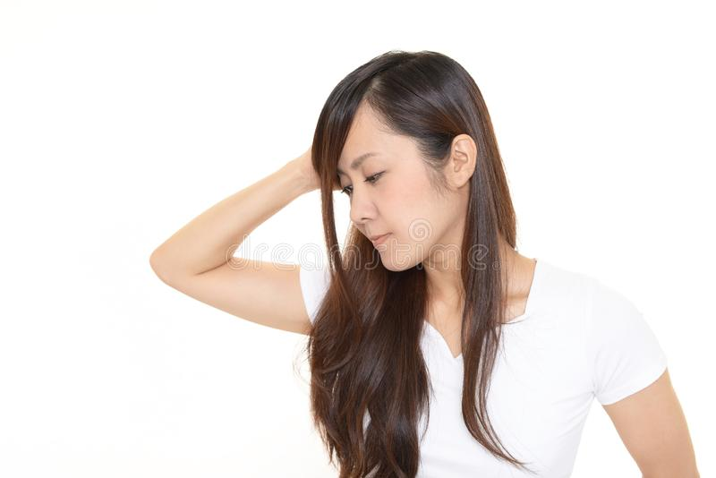 Uneasy Asian woman royalty free stock image