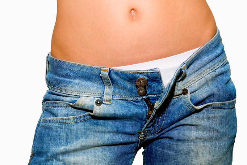 Woman with unfastened jeans royalty free stock image