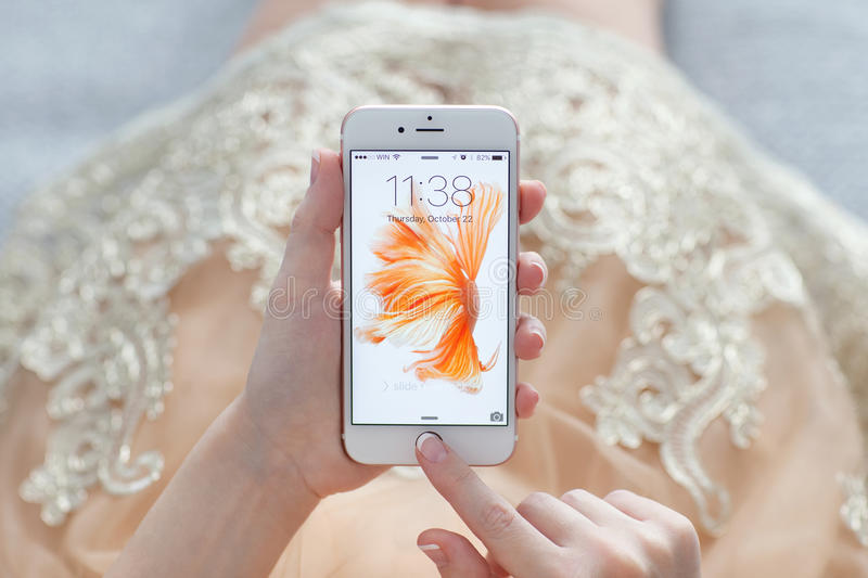 Woman unlock iPhone 6S Rose Gold with live photo stock images