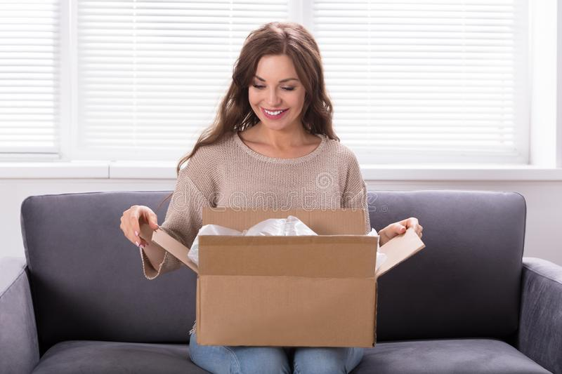 Woman Unpacking Received Parcel royalty free stock photo