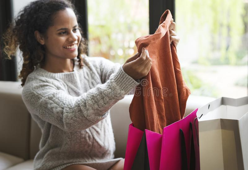 Woman unpacking a shopping bag stock photo