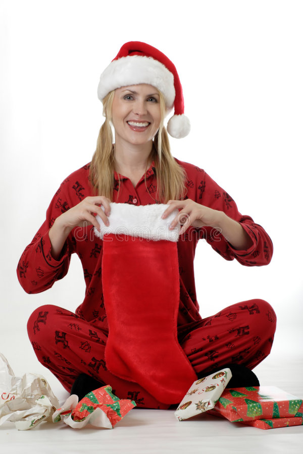 Woman unwrapping gifts on Christmas stock images