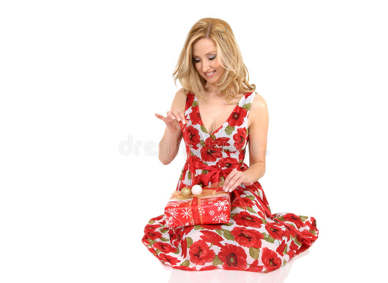 Woman unwrapping present royalty free stock photos