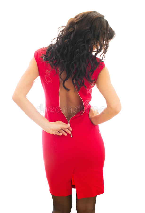 Woman unzips her red dress. Isolated on white stock photo