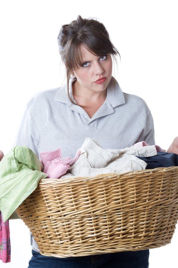 Free Woman Upset Doing Laundry; Isolated Royalty Free Stock Images - 10256799