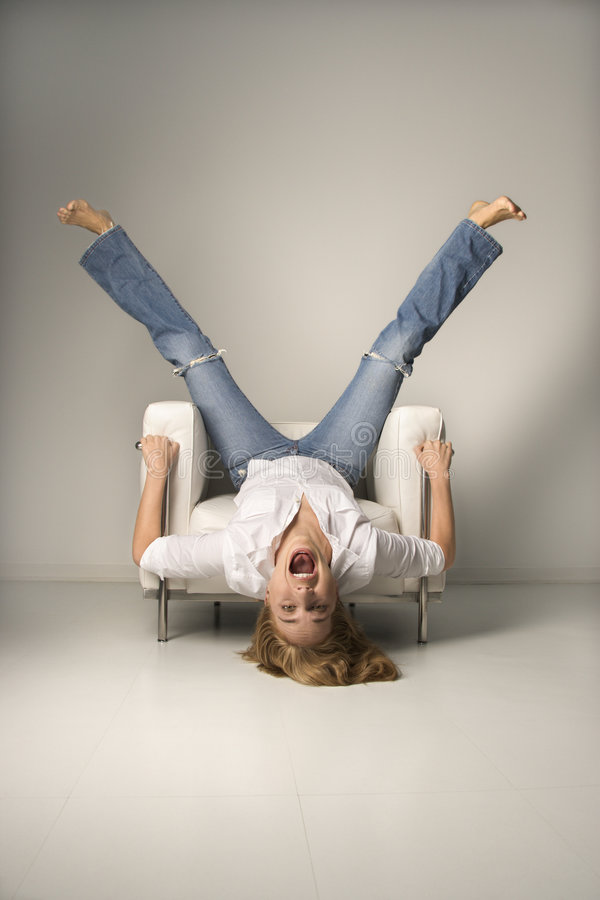 Download Woman Upside Down In Chair. Stock Photography - Image: 2424652