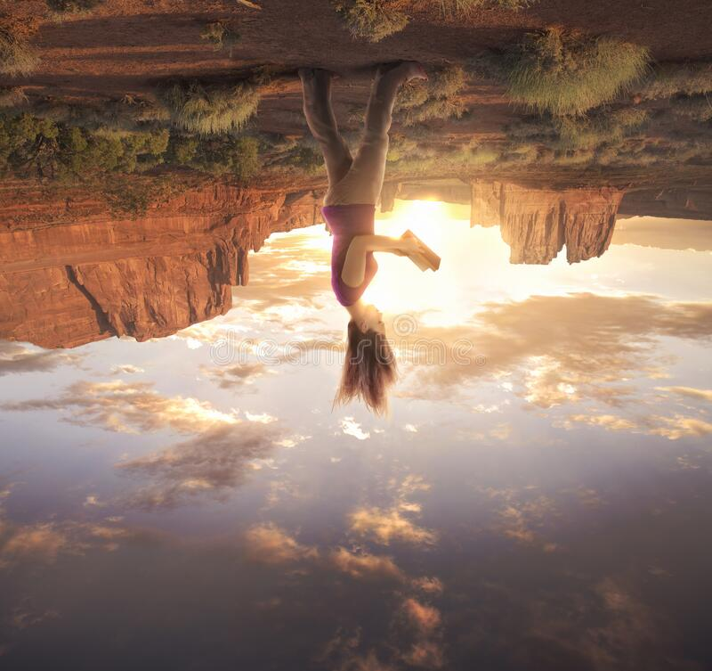 Woman on upside down world stock photography