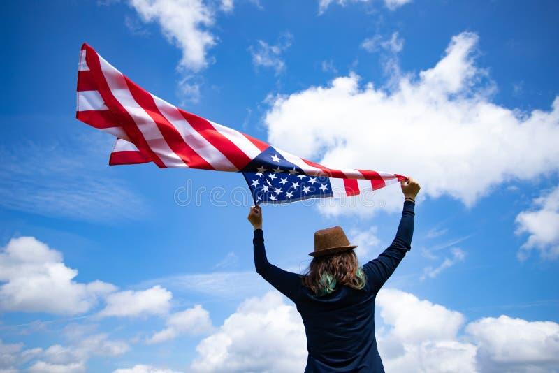 Woman with USA flag royalty free stock image