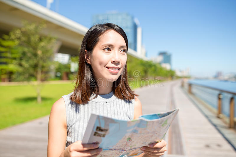 Woman use of city map in Hong Kong. City stock images
