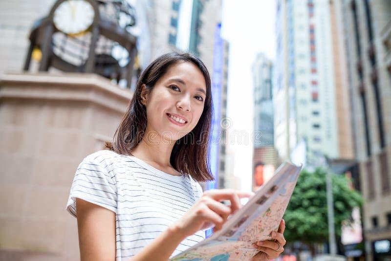 Woman use of city map in Hong Kong. City royalty free stock image
