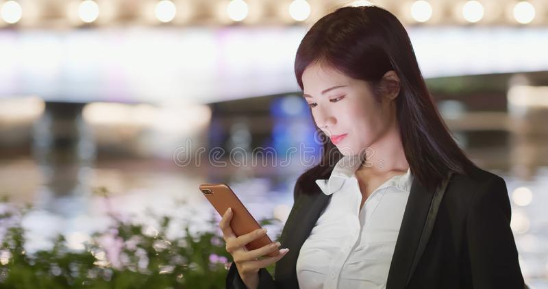 Woman use phone in city stock image
