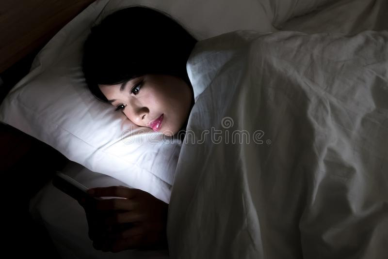 Woman use phone. Happily in the evening stock images