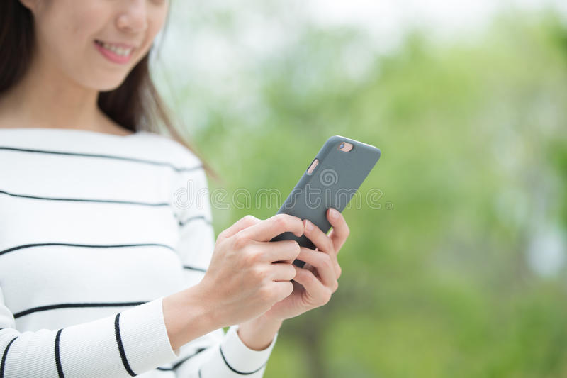Woman use smart phone. Happy woman use smart phone outdoor, asian beauty royalty free stock images