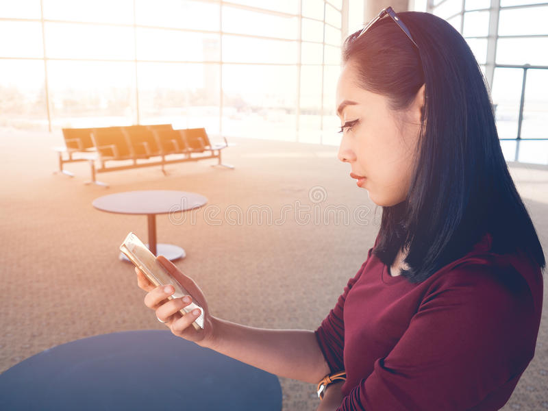 Woman use smartphone in airport. stock images