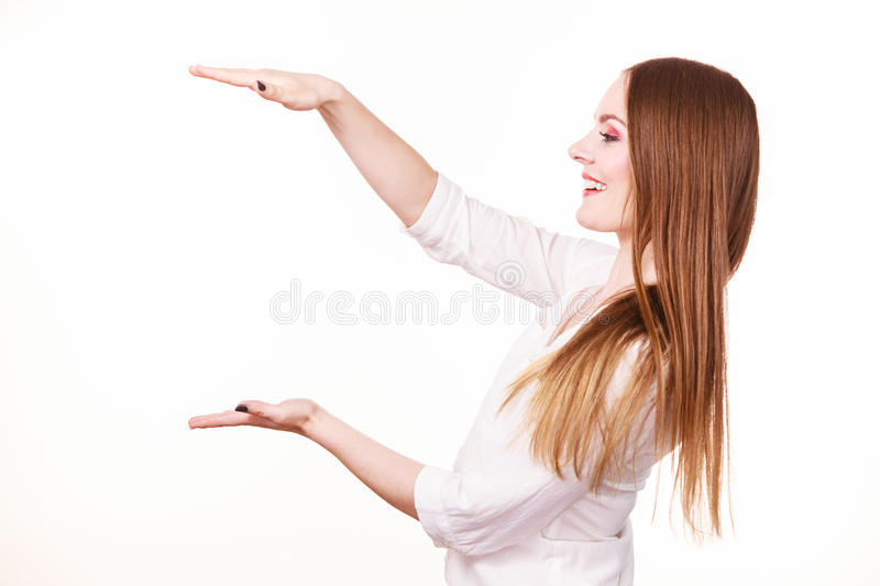Woman uses hands to indicate area of frame, copy space for product stock photos