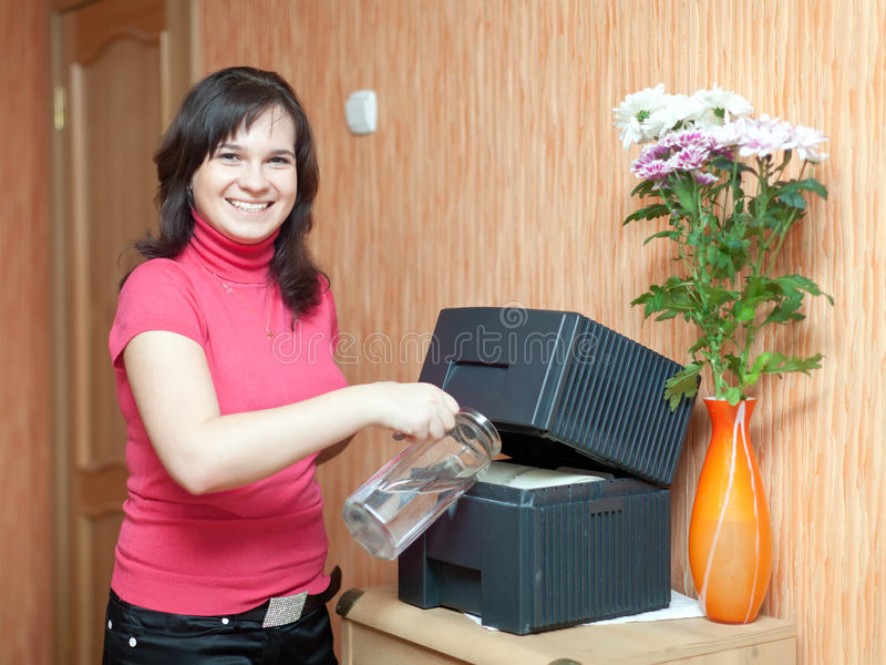 Woman uses humidifier stock photo