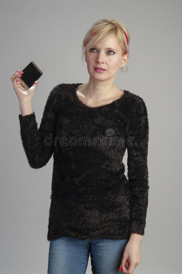 Woman usin cell phone stock photo